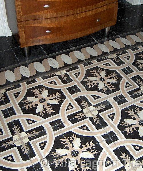 "Villa Lagoon Tile's exclusive ""Trapani Midnight"" cement tile, installed on a bedroom floor."