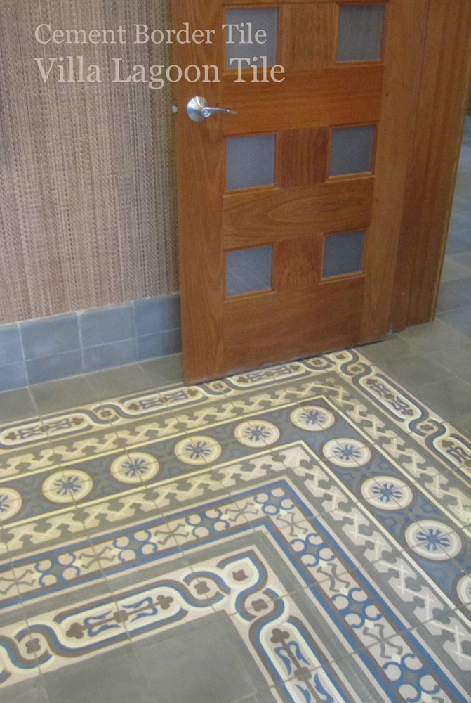 A very deep encaustic cement tile border at the corner of a room using Caribbean Collection and Cuban Heritage Collection border patterns.