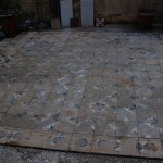 antique cement tile before cleaning