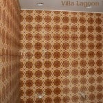 "Two walls of the men's room of the Flying Iguana, during construction. Villa Lagoon Tile's ""Bocassio Gold"" decorative cement tile are installed, with the photo taken before grouting and the final sealing."