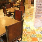 The dining room of the Flying Iguana, with a good view of the patchwork cement tile used as flooring.
