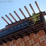 "A close-up shot of the Flying Iguana signage. A stylized wooden framework holds the sign over a facade of 10"" Tradewinds decorative cement tile, exclusive to Villa Lagoon Tile."