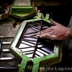 Cement tile production. The Moroccan artisan is inserting the cement tile pattern mold into the shape mold.