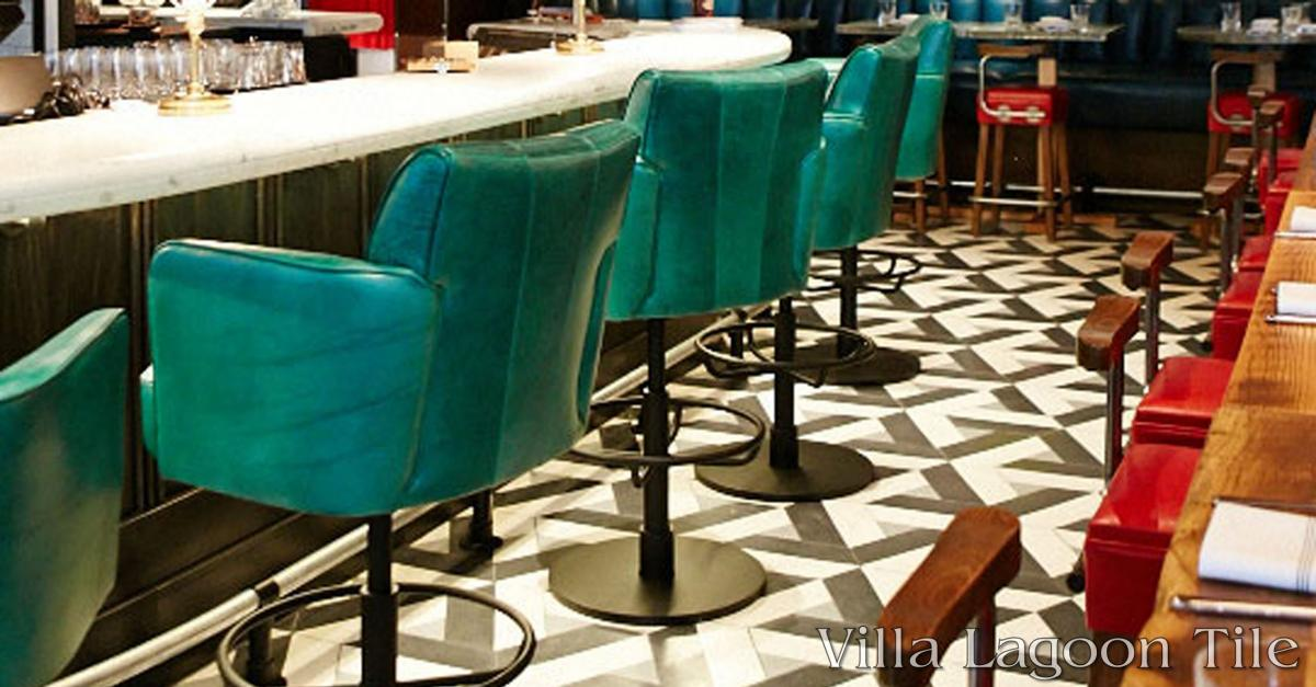 A portion of the marble bar and custom cement tile floor of the Drake One Fifty.