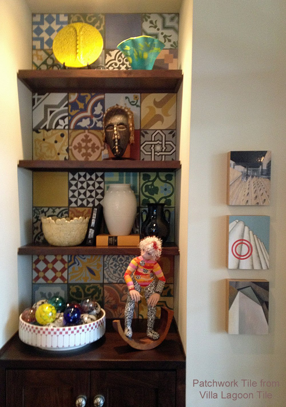 Built in shelves with colorful patchwork tile as a back feature