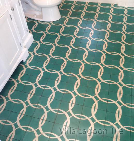 A custom cement tile floor, from Villa Lagoon Tile, in a Bahamian white bathroom.