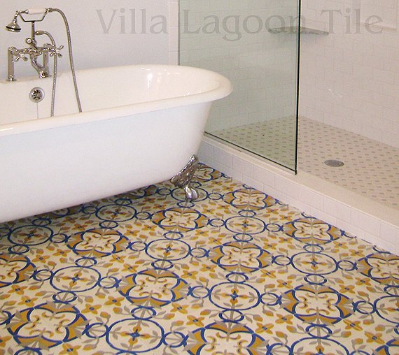 Custom cement tile from Villa Lagoon Tile, paired with a clawfoot tub for a beautiful bathroom.