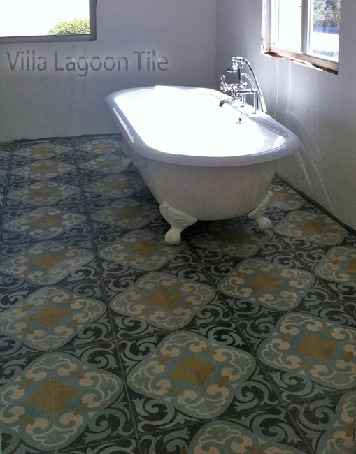 La Espanola cement tile from Villa Lagoon Tile, with a clawfoot tub, in a white bathroom.