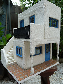 A miniature home, with reproduced Villa Lagoon Tile.