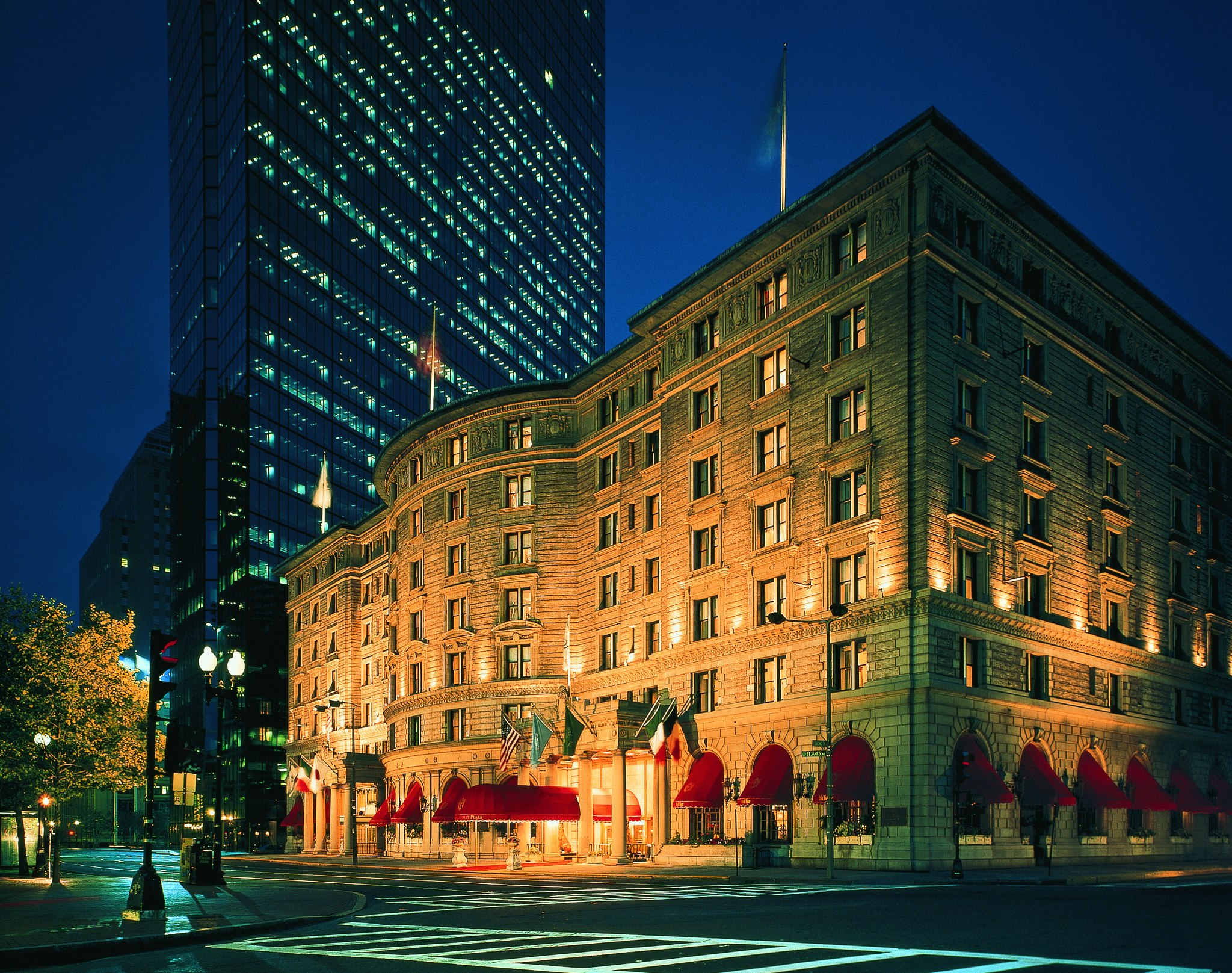 Night time photo of the Fairmont Copley Hotel