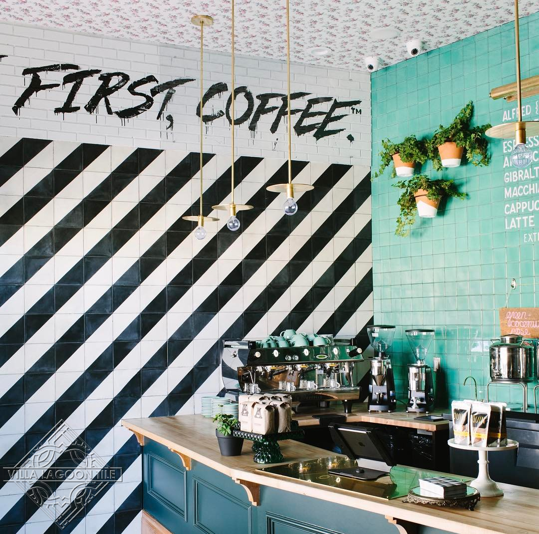 Coffee house with bold black and white stripes created by Villa Lagoon Tiles Man Overboard cement tile.