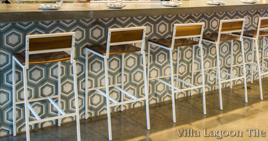 Front of bar tiled with our concentric hex cement tile.