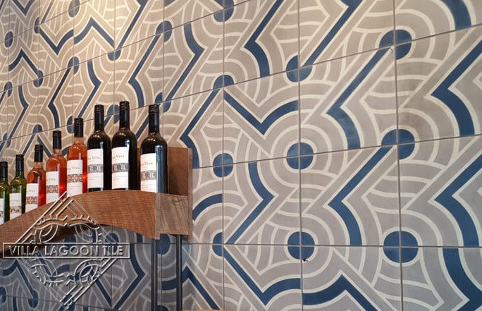 Wall featuring our Props cement tile in gray, blue, and white.