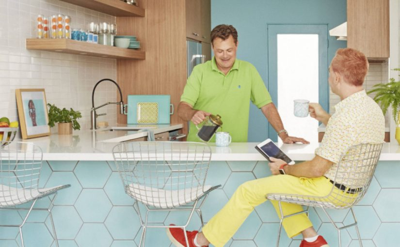 Photo from July 2018 HGTV magazine featuring our solid Seaside Blue hexagonal cement tile on the front of the counter.