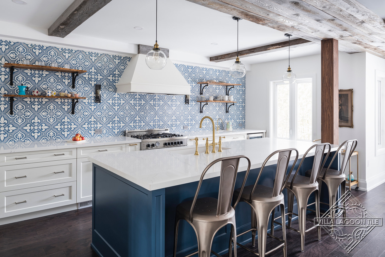 Open kitchen with Lancelot blue cement tile backsplash and feature wall