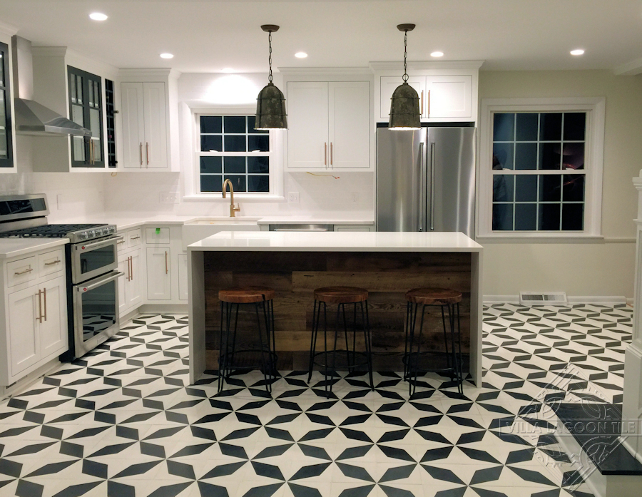 Simple and bold black and white cement tile kitchen floor.