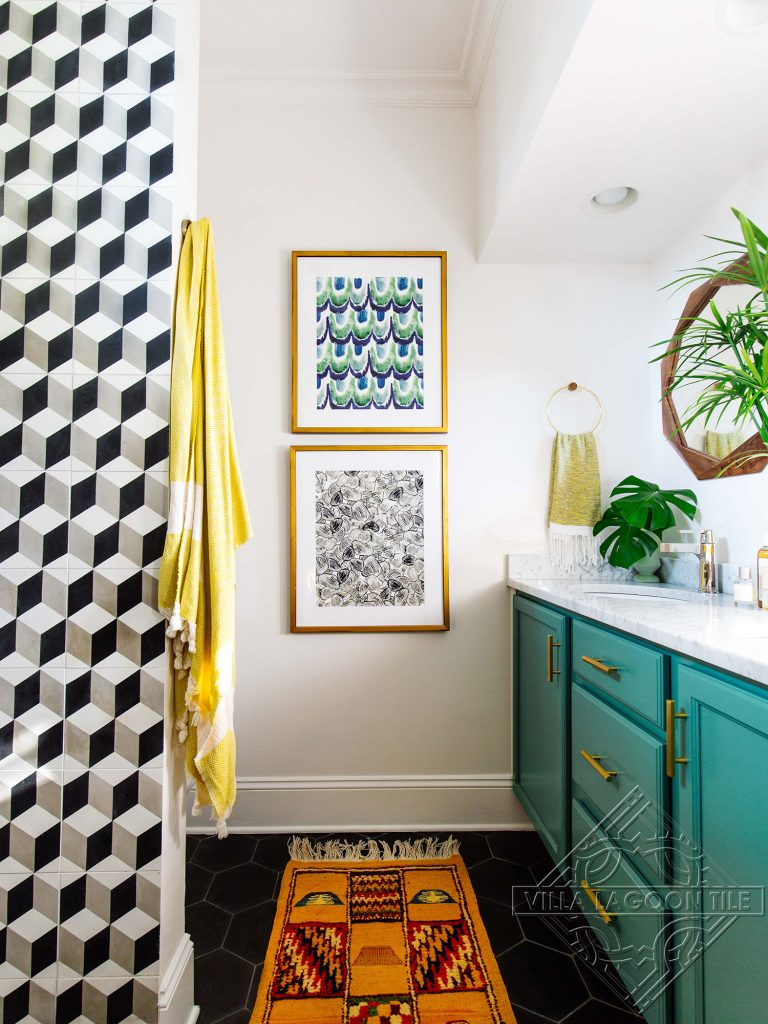 Black hexagonal shaped cement tile floor and classic cube cement tile pattern on the wall create a fun modern bathroom.