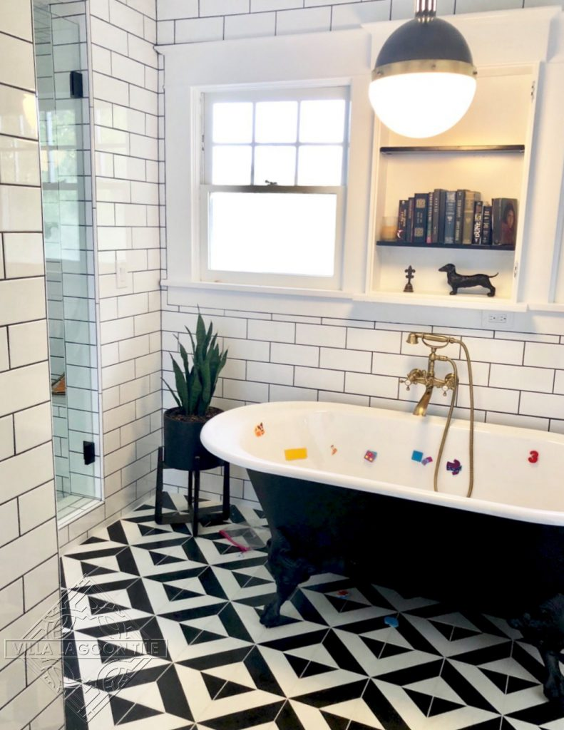 Geometric cement tile pattern in a basic diagonal stripe creates a bold bathroom floor.