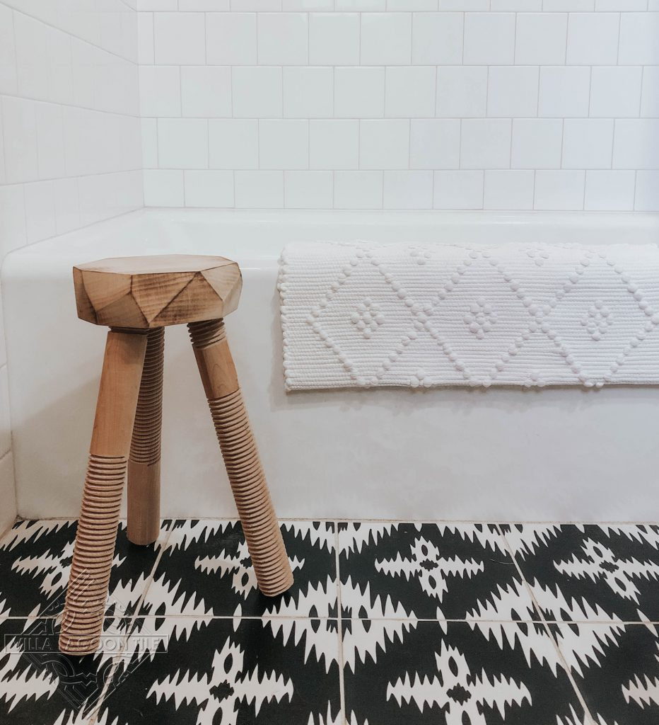 Bathroom floor featuring our Ikat cement tile pattern in black and white.