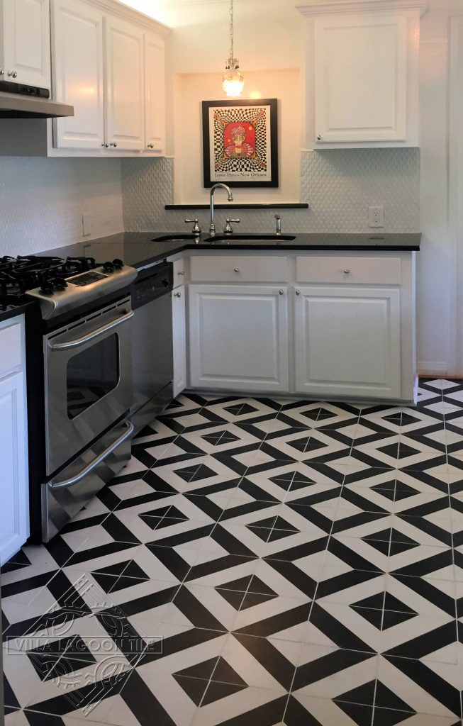 Geometric cement tile pattern in a basic diagonal stripe creates a bold kitchen floor.