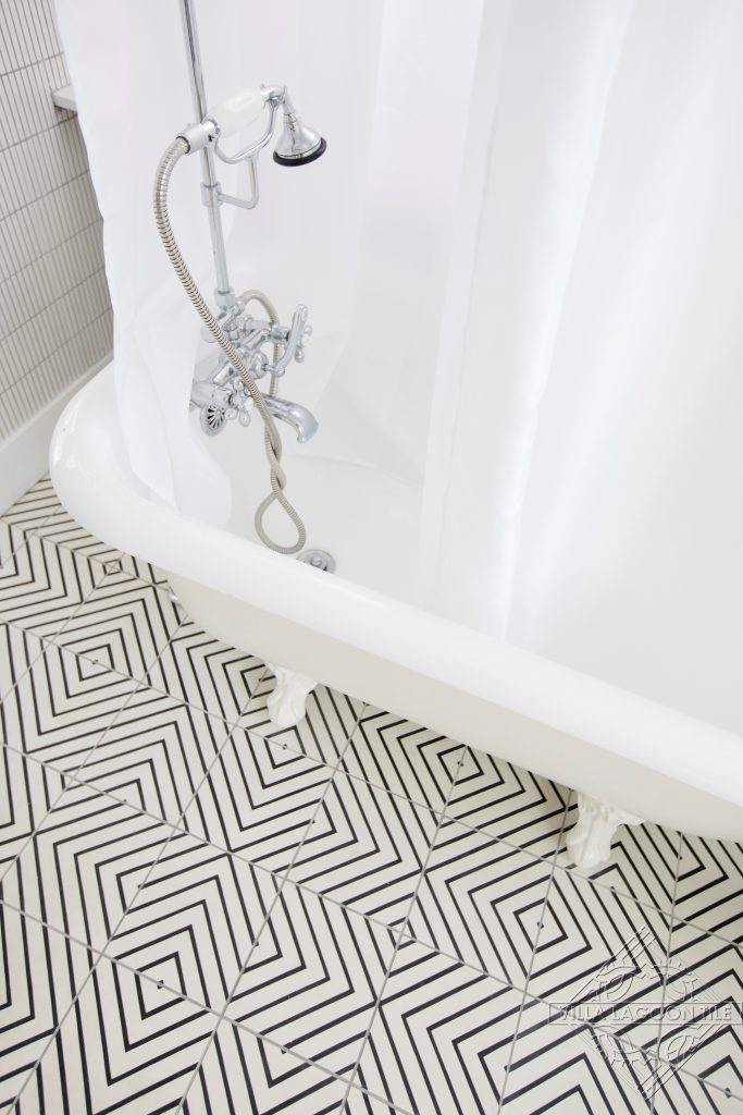 Modern black and white maze pattern cement tile floor.