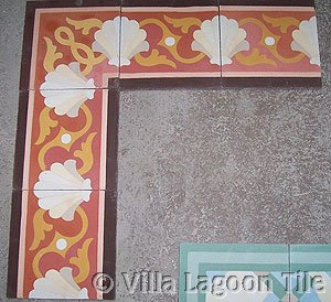 Shell Scroll Border Tile in Coral