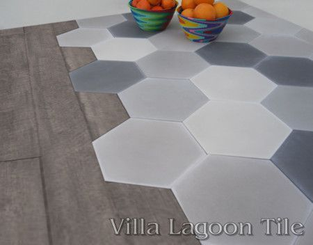 Mixed Gray Hexagonal tile and Hardwood flooring.