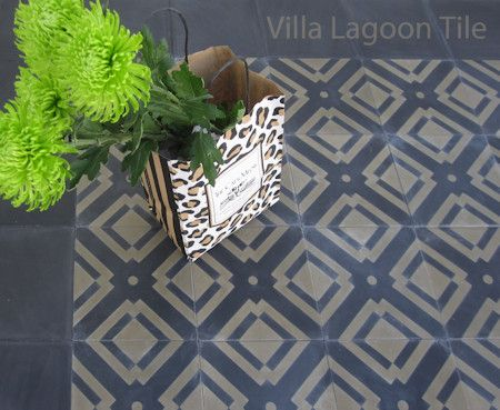 Manhattan Cement Tile, with a Solid Black border, and a bag of flowers.