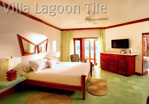 Single color green cement tile hotel room floor.